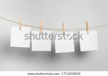 photo  frame.Retro photo frames hanging on rope isolated on white background. real photo.four frames ストックフォト ©