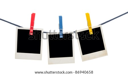 photo frames on a rope isolated on white
