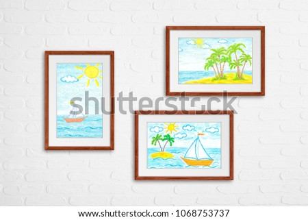 Photo frames on white bricks wall. Colored pencils drawings collage ...