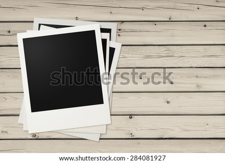 photo frames on wooden background