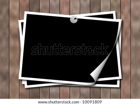 Photo-framework on a wooden surface - stock photo