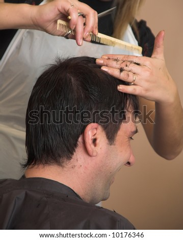 Photo from a beauty saloon about work of the hairdresser