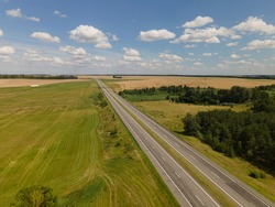 Photo from a flying drone, highway road on a sunny day in summer