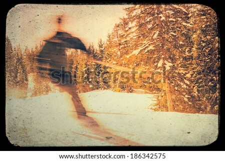 Photo from blurred skier on piste with vintage effects