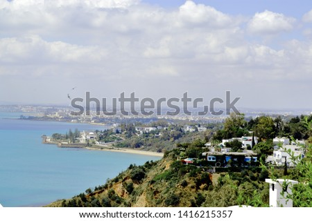 Photo from viewpoint over the gulf of Tunis taken from Sidi Bou Said the blue city it shows the mediterranean sea of Tunis, Tunisia on the coast you see La Goulette La Kram and Carthago. #1416215357