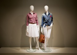 Photo full-length female clothes on a two mannequin with bag