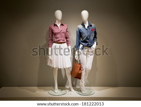 Shutterstock Photo full-length female clothes on a two mannequin with bag