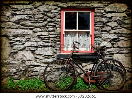 photo grunge texture rural irish cottage with bicycle
