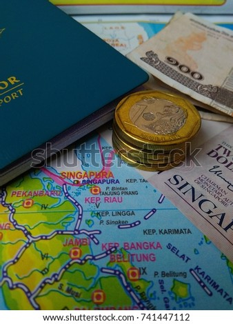 Photo Illustration of Budget Calculating for journey from Indonesia to Singapore.