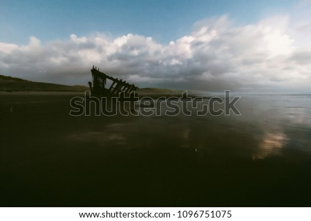 Photo Illustrative - Retro film grain and toned image of the Peter Iredale shipwreck #1096751075