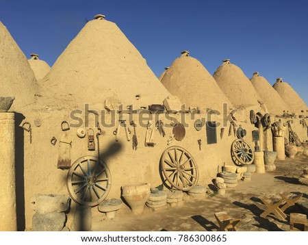 Photo is taken in Harran, Sanliurfa Turkey. This is the photo of the typical Harran house. Houses is made of mudbrick. Conic shaped and mudbrick and conic roofs are special to Harran area.