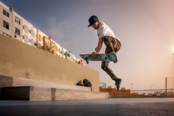 photo 1 (jump). Young skater does a trick called boneless. skateboarding