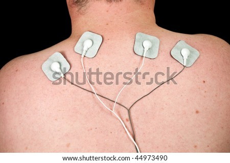 photo male with acute neck pain, electrodes to tens unit