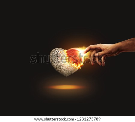 photo manipulation of heart of stone turning into flesh by the touch of Jesus, dark background, christian religious conversion concept from Bible Ezekiel