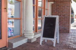 Photo Mock up of Blank Sandwich Style POP Advertising Chalkboard Sign Outside Storefront