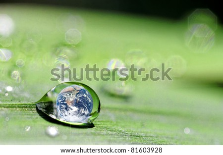 photo montage where the earth is inside a drop