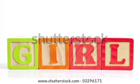 photo of a alphabet blocks spelling girl