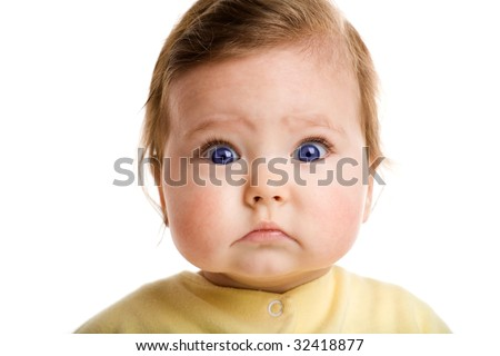 Photo of a baby, staring at camera, isolated on white
