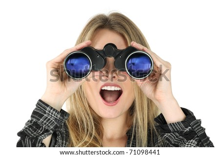 Photo of a beautiful blond woman searching with binoculars and looking surprised.