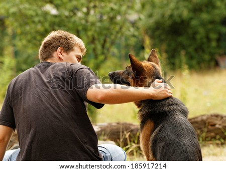 Photo of a beautiful friendship with a boy and a dog