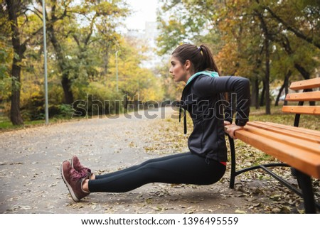 Photo of a beautiful pretty young pretty fitness woman outdoors in the park make sport exercises. #1396495559