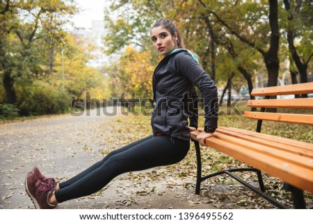 Photo of a beautiful pretty young pretty fitness woman outdoors in the park make sport exercises. #1396495562