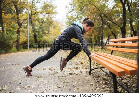 Photo of a beautiful pretty young pretty fitness woman outdoors in the park make sport exercises. #1396495565