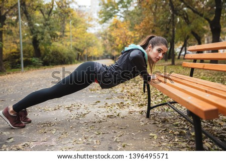 Photo of a beautiful pretty young pretty fitness woman outdoors in the park make sport exercises. #1396495571