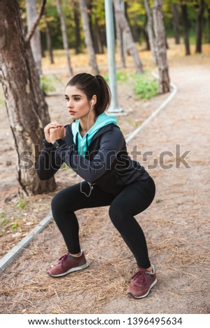 Photo of a beautiful pretty young pretty fitness woman outdoors in the park make sport exercises. #1396495634