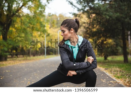 Photo of a beautiful pretty young pretty fitness woman outdoors in the park make sport exercises. #1396506599