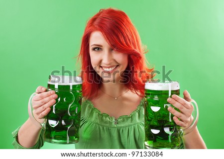 Photo of a beautiful redhead holding two huge mugs of green beer for St. Patricks Day celebrations.