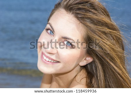 Photo of a beautiful young woman by the sea