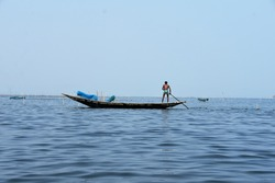 Photo of a boat on lake  during a sunny afternoon in odisha,Chile.