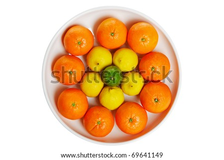 Photo of a bowl full of citrus fruits isolated on a white background, clipping path for the bowl.