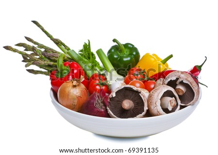 Photo of a bowl of vegetables isolated on a white background, part of the ingredients for a mediterranean meal.