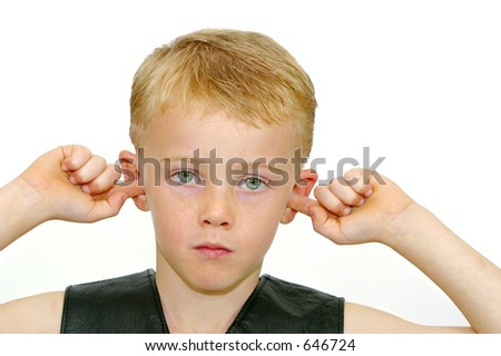Photo of a boy with his fingers in his ears.