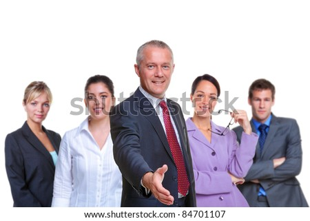 Photo of a business team, focus on the manager with his hand out in a welcoming gesture, isolated on a white background.