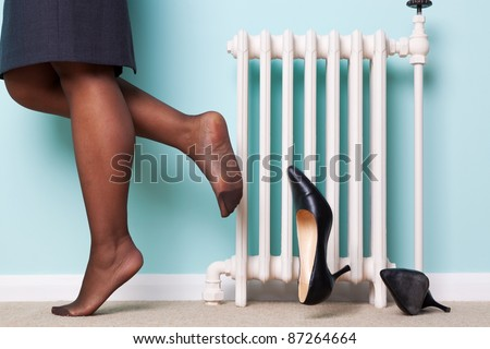 Shoes off as she returns home after a hard day at work motion blur on