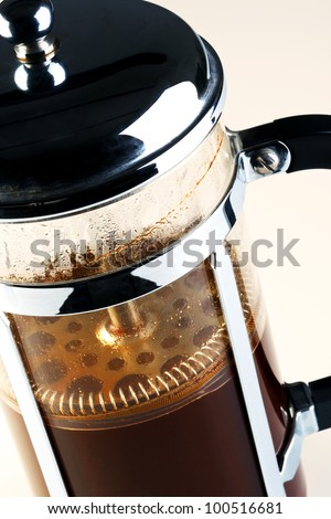 Photo of a Cafetiere with freshly brewed coffee inside, this is also know as a French press, Coffee plunger, Coffee press or Caffettiera.
