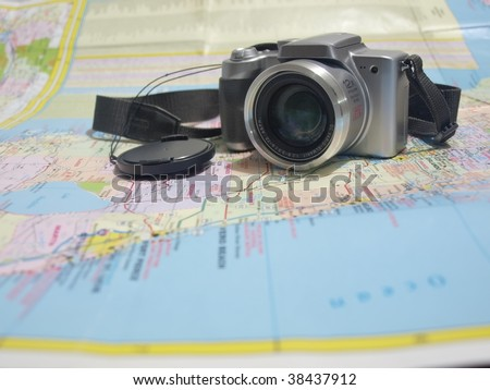 photo of a camera on a road map of the state of Florida. This is a concept photo for travel and tourist related subjects.