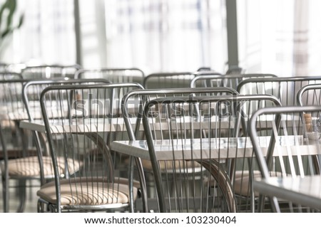 Photo of a canteen with metal chairs and tables