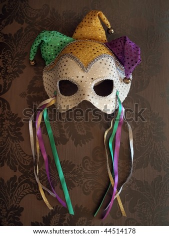 photo of a carnival mask on decorative fabric