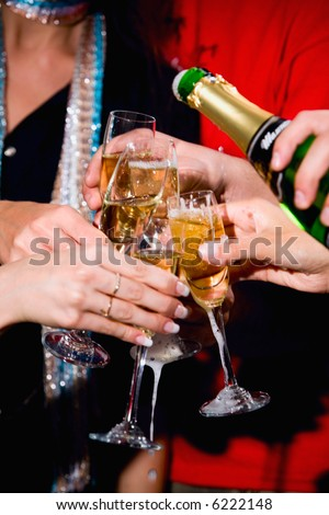 Photo of a champagne pouring into the glasses