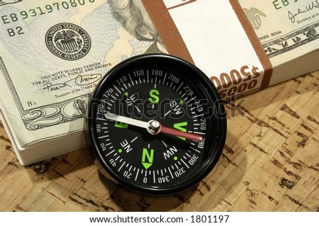 Photo of a Compass and Cash - Market Direction Concept