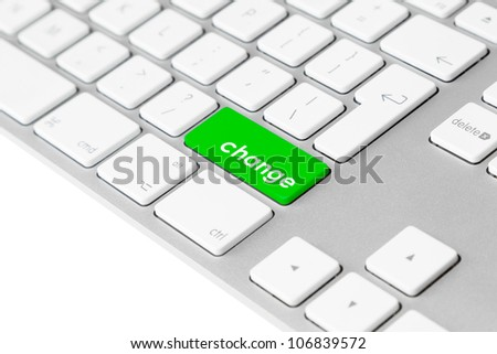 "Photo of a computer keyboard with one green key with the word ""change""."