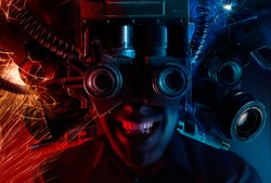 Photo of a cyberpunk male head portrait with robotic helmet with wires, metal parts and binoculars on black background.