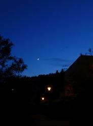 Photo of a dark blue evening sky above a city