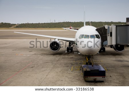 Photo of a docked plane in the airport