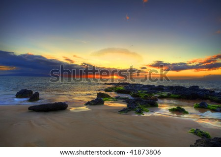 photo of a dramatic sunset on the beach