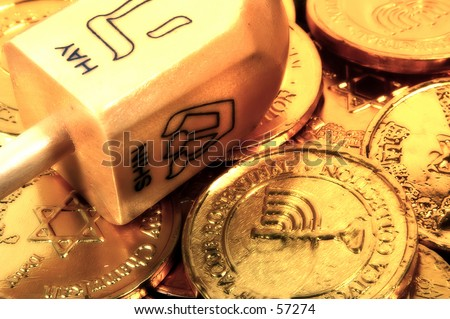 Photo of a Dreidel and Gelt With Blur Effect - stock photo